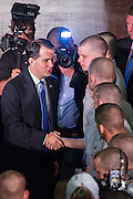 Wisconsin Governor and GOP presidential candidate Scott Walker greets cadets after he gave a foreign policy speech at the Citadel military college August 28, 2015 in Charleston, South Carolina. Walker criticized Hillary Clinton as unfit for the presidency because of her role in negotiating with Iran and her use of a private email system.