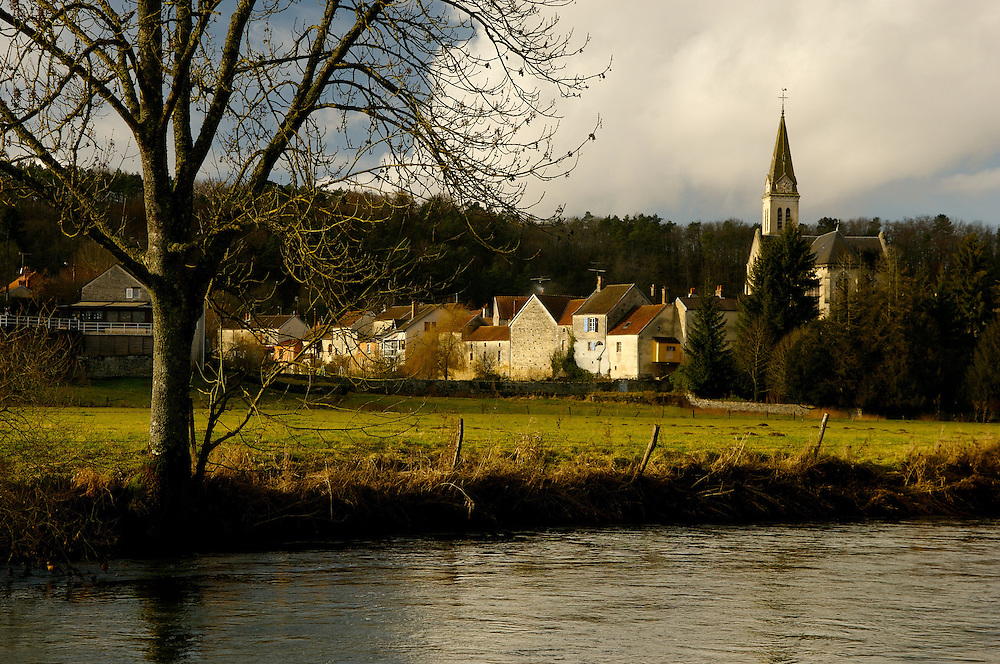 Steeple along river in Normandy region of France.