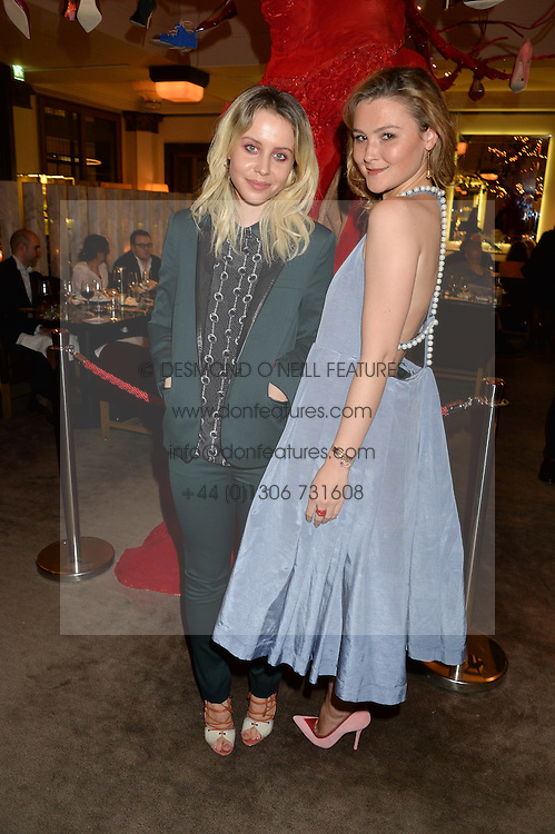 Left to right, BILLIE JD PORTER and AMBER ATHERTON at the unveiling of a Very Special Malone Souliers Christmas Tree, In Support Of Starlight Children's Foundation held at The Club Cafe Royal, Regent Street, London on 2nd December 2015.