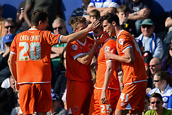 Blackpool celebrate the goal scored by Blackpool's forward David Goodwillie  - Photo mandatory by-line: Mitchell Gunn/JMP - Tel: Mobile: 07966 386802 29/03/2014 - SPORT - FOOTBALL - Loftus Road - London - Queens Park Rangers v Blackpool - Championship