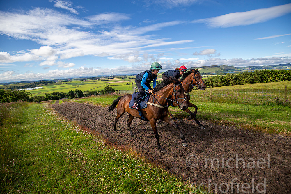 Lucy Alexander wearing the blue top on the horse called Final Reminder. Father and daughter trainer/ jockey team Nick and Lucy Alexander at Kinneston stables, Leslie, Fife. Start regarding the launch of the Scottish Sun Family Raceday at Perth races