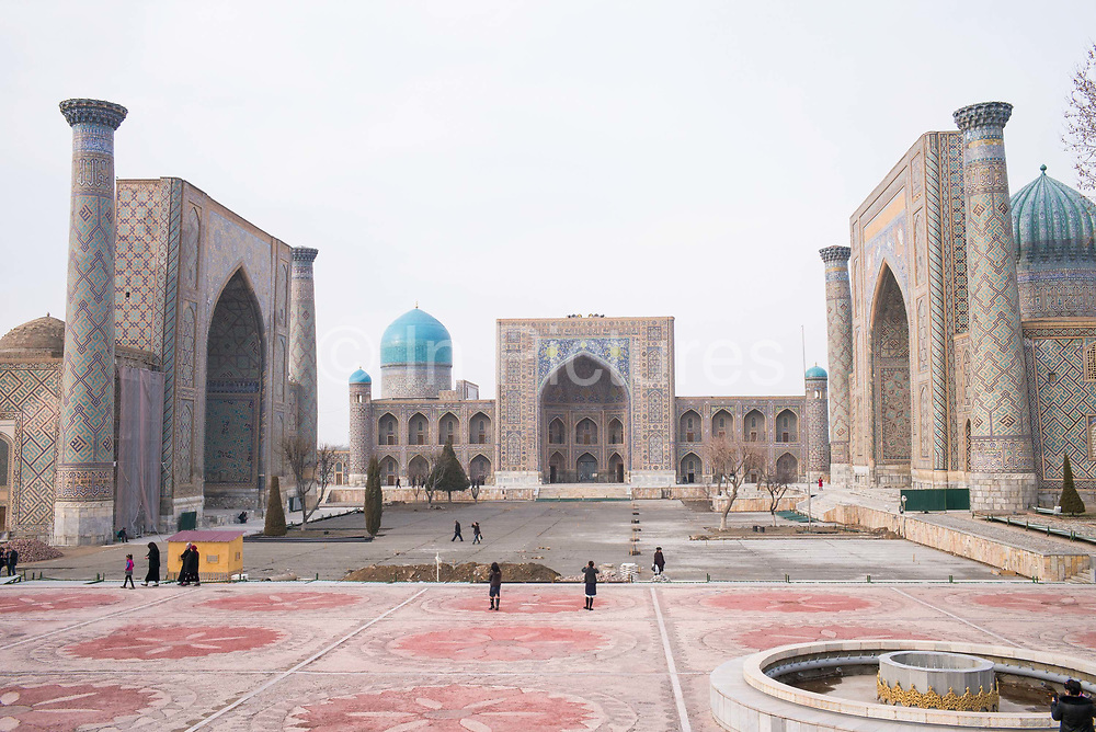 Registan Square on 21st February 2014 in Samarkand in Uzbekistan. The Registan was the heart of the ancient city of Samarkand of the Timurid dynasty. The name Registan means Sandy place or desert in Persian.