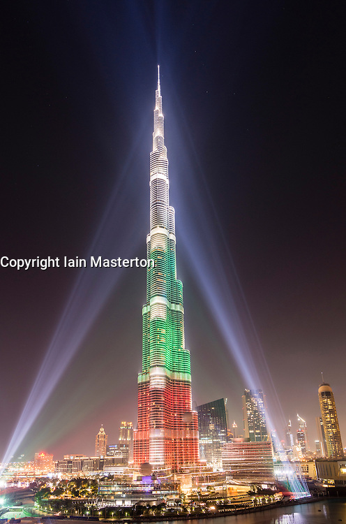 Evening view of Burj Khalifa skyscraper illuminated with national flag colours in Dubai United Arab Emirates