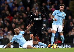 Manchester City's Fabian Delph (left) and Kyle Walker (right) battle for the ball with West Ham United's Pedro Obiang (centre) during the Premier League match at the Etihad Stadium, Manchester.