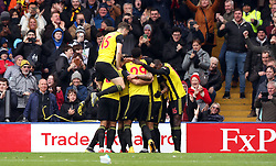 Watford's Andre Gray (obscured) celebrates scoring his side's second goal of the game with team-mates during the FA Cup quarter final match at Vicarage Road, Watford.