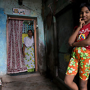 Tanaz (11) and her mother Zarena at the entrance to Tasleem beauty parlor, named after Zarena's eldest daughter.