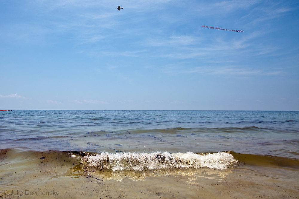 Oil in the waves washing on shore  at Orange Beach, Alabama on June 12, 2010 from the  BP spill.