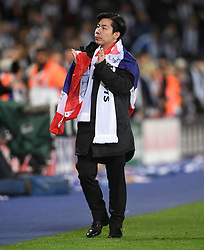 Leicester City vice chairman Apichet Srivaddhanaprabha applauds the fans after the final whistle of the Premier League match at the King Power Stadium, Leicester.