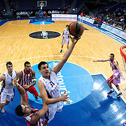 Anadolu Efes's Milko Bjelica (C) during their Gloria Cup Basketball Tournament match Anadolu Efes between Olympiacos at Ulker Sports Arena in istanbul Turkey on Tuesday 23 September 2014. Photo by Aykut AKICI/TURKPIX