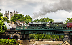 © Licensed to London News Pictures. 27/05/2021. York UK. 1930's steam Locomotive 45562 Alberta crosses the River Ouse in York city centre this morning pulling the Scarborough Spa Express to Scarborough on the Yorkshire coast. Photo credit: Andrew McCaren/LNP
