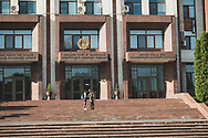 A German tourist is reprimended by a guard for taking a close-up picture of the Supreme Council, or parliament, in Tiraspol, the capital of Transnistria (Pridnestrovian Moldavian Republic).