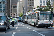 An SFMTA Traffic Enforcement Officer directs traffic for cars headed towards the Bay Bridge. A Bart strike caused chaos for commuters coming in and out of San Francisco. AC Transit and San Francisco Bay Ferry managed the trans bay commutes, while Muni handled the dissplaced commuters within San Francisco.   July 2, 2013