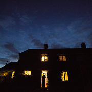 Hermit Sister Rachel Denton looks at the evening sky from  the doorway of St Cuthberts' Hermitage in Lincolnshire, north east Britain September 25, 2015. Sister Rachel Denton has vowed to spend the rest of her life living as a consecrated hermit in the Catholic faith. A hermit is a person who chooses to live alone, with the intention of finding God. Rarely leaving her house she lives a life of prayer and solitude. However, she uses the internet and social media to share her experience and distance her self from physically interacting with society. REUTERS/Neil Hall