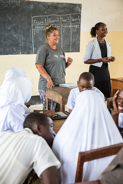 ICS volunteer Charlotte Clough in discussion with students at Angaza school as part of the VSO / ICS Elimu Fursa project (Opportunities in Education) Lindi, Lindi region. Tanzania.