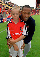 Thierry Henry with the Arsenal mascot. Bradford City 1:1 Arsenal, F.A. Carling Premiership, 9/9/2000. Credit Colorsport / Stuart MacFarlane.