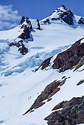 Climbers ascend the Blue Glacier under Mount Olympus East Peak in Olympic National Park, Washington, USA. Olympic National Park is a UNESCO World Heritage Site. May 30, 1982.