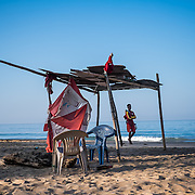A lifeguard takes the first morning tour on Agonda beach. A traditional fishing village, Agonda has maintained a simplicity and charm that have earned it a reputation of one of the top beach destinations in Asia.