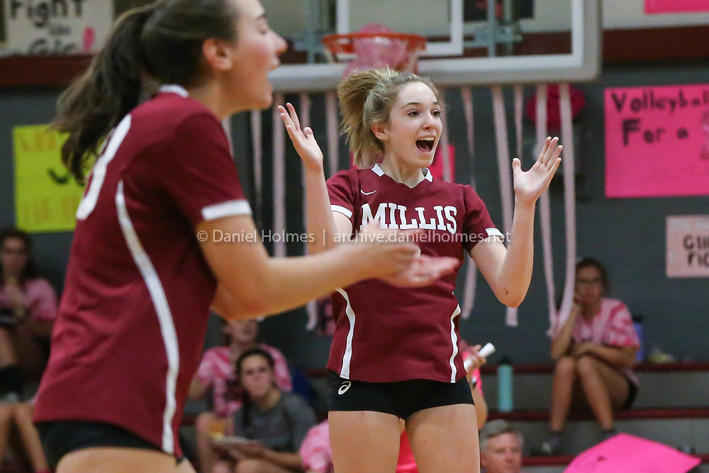 (10/15/19, MILLIS, MA) Millis' Mahoney Cyr, left, and Julia Olmstead celebrate a point against Bethany Christian during the 13th annual Volleyball For A Cure night at Millis High School on Tuesday. [Daily News and Wicked Local Photo/Dan Holmes]