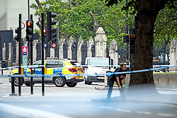 Police on Westminster Bridge, central London, after a car crashed into security barriers outside the Houses of Parliament.