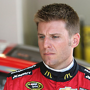 Sprint Cup Series driver Jamie McMurray (1) is seen in the garage area during the 57th Annual NASCAR Coke Zero 400 practice session at Daytona International Speedway on Friday, July 3, 2015 in Daytona Beach, Florida.  (AP Photo/Alex Menendez)