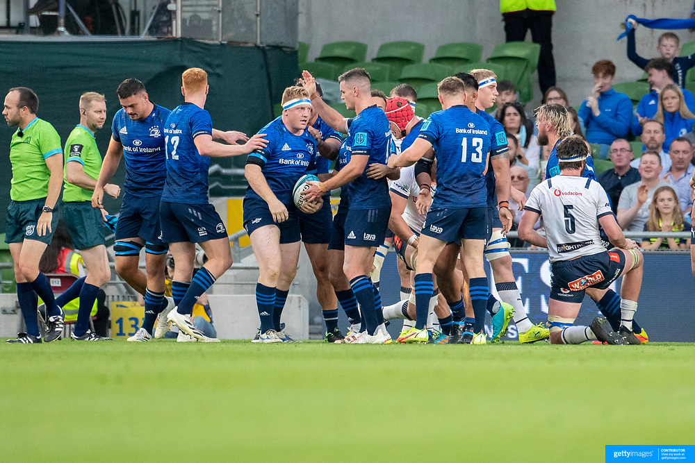 DUBLIN, IRELAND:  September 25:  James Tracy #16 of Leinster is congratulated by team mates after scoring a push over try during the Leinster V Bulls United Rugby Championship match at Aviva Stadium on September 25th, 2021 in Dublin, Ireland. (Photo by Tim Clayton/Corbis via Getty Images)