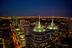 Aerial view of downtown Houston skyline and city lights at night featuring the Texas Medical Center and St. Luke's tower in the foreground.