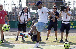 Mercedes' Lewis Hamilton kicks a football in front of the media during the paddock day of the 2018 British Grand Prix at Silverstone Circuit, Towcester.