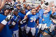 Dec 1, 2012; Tulsa, Ok, USA; Tulsa Hurricanes tailback Willie Carter (34) and teammates react following a game against the University of Central Florida Knights at Skelly Field at H.A. Chapman Stadium. Tulsa defeated UCF 33-27 in overtime to win the CUSA Championship. Mandatory Credit: Beth Hall-USA TODAY Sports