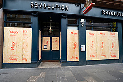 Glasgow, Scotland, UK. 1 April, 2020. Effects of Coronavirus lockdown on streets of Glasgow, Scotland. Revolution Bar is boarded up and closed.