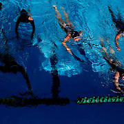 On Thursday, November 3, during the Orange Empire Conference Women's water polo championship,  the Orange Coast College girls swim over to the edge to take a small break from the game against Saddleback College in Mission Viejo, CA. Orange Coast College won the game with the final score of 11 to 4. Photograph taken by ©Mikailin Rae Perry, Sports Shooter Academy