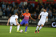 Vincent Kompany of Manchester city © looks to go past Jay Fulton of Swansea city.  EFL Cup. 3rd round match, Swansea city v Manchester city at the Liberty Stadium in Swansea, South Wales on Wednesday 21st September 2016.<br /> pic by  Andrew Orchard, Andrew Orchard sports photography.