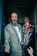 Russian Nobel prize novelist Alexander Solzhenitsyn signs a copy of his book after arriving by train returning to his homeland June 5, 1994 in Khabarovsk, Russia. Solzhenitsyn was expelled from the Soviet Union in 1974 but returned after the fall of the Soviet Union.
