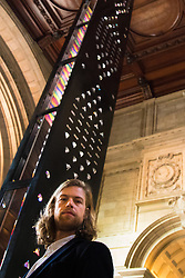 London, September 18th 2015. Zotem, supported by Swarovski.<br /> This 18m tall double-sided monolith stretches up two floors from the entrance through to the Ceramics Gallery. <br /> It was created by young Norwegian designer Kim Thomé and presents a dynamic optical illusion.<br />  The Victoria and Albert museum celebrates the London Design Festival, which runs from 19 – 27 September, with a collection of conceptual installation artworks.