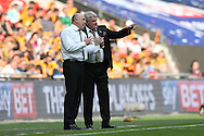 Steve Bruce, the Hull City manager (r) talking to Mike Phelan, the Hull City assistant manager on the touchline during the 1st half. Skybet football league Championship play off final match, Hull city v Sheffield Wednesday at Wembley Stadium in London on Saturday 28th May 2016.<br /> pic by John Patrick Fletcher, Andrew Orchard sports photography.