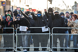 """© Licensed to London News Pictures . 26/11/2016 . Bolton , UK . Those opposed to mosques , pictured giving Nazi salutes at the demonstration . Approximately 100 people attend a demonstration against the construction of mosques in Bolton , under the banner """" No More Mosques """" , organised by a coalition of far-right organisations and approximately 150 anti fascists opposing the demonstration , in Victoria Square in Bolton Town Centre . Photo credit : Joel Goodman/LNP"""