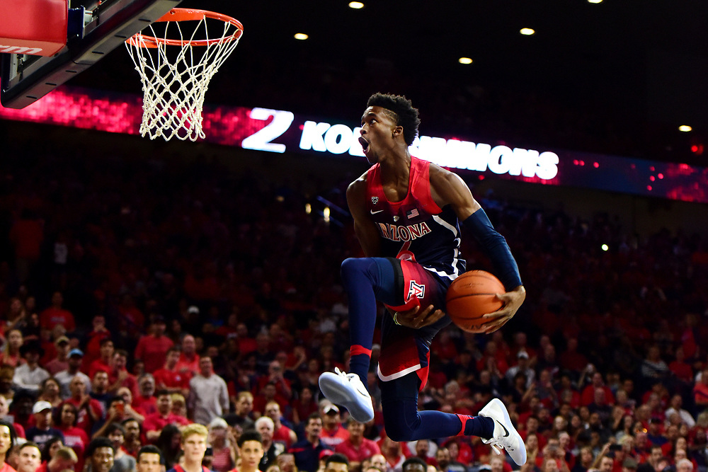 Arizona guard Kobi Simmons (2) soars up to the basket during the slam dunk contest before the red and blue scrimmage at McKale Center in Tucson, Arizona on Friday, Oct. 14, 2016. (Rebecca Noble/The Daily Wildcat)