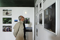 October 31, 2018 - Kyiv, Ukraine - A visitor looks at showpieces at the Photo Kyiv Fair 2018, Kyiv, capital of Ukraine, October 31, 2018. This year, more than 500 photos will be on display on November 1-4. The event will bring together famous photographers, art curators and gallery owners from around the world. Ukrinform. (Credit Image: © Ovsyannikova Yulia/Ukrinform via ZUMA Wire)