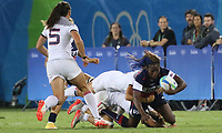 August 08, 2016; Rio de Janeiro, Brazil; USA Women's Eagles Sevens Victoria Folayan is caught by the French defense during the Women's Rugby Sevens 5th Place Play-Off match on Day 3 of the Rio 2016 Olympic Games at Deodoro Stadium. Photo credit: Abel Barrientes - KLC fotos