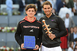 May 14, 2017 - Madrid, Spain - RAFAEL NADAL OF Spain  poses with the under 16s tournament winner JAIME CALDES of Spain after the final of the Mutua Madrid Open tennis tournament. (Credit Image: © Christopher Levy via ZUMA Wire)