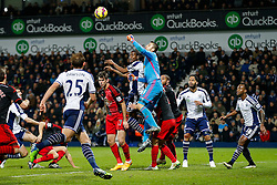 Lukasz Fabianski of Swansea City punches clear as Brown Ideye of West Brom challenges - Photo mandatory by-line: Rogan Thomson/JMP - 07966 386802 - 11/02/2015 - SPORT - FOOTBALL - West Bromwich, England - The Hawthorns - West Bromwich Albion v Swansea City - Barclays Premier League.