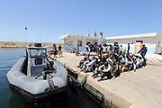 TRIPOLI, June 7, 2016 <br /> <br />  Illegal migrants sit on the dock at the Tripoli port in Tripoli, Libya on June 7, 2016. Some 117 illegal migrants of African origins including six pregnant women were rescued by two coast guard boats at sea on Tuesday. <br /> ©Exclusivepix Media