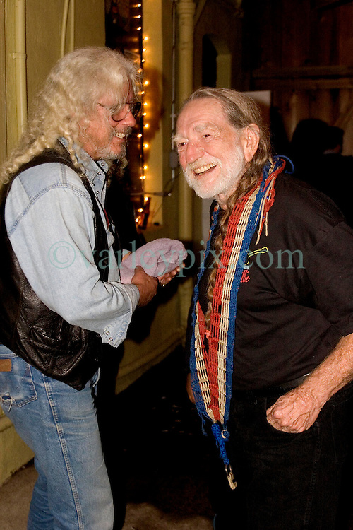 17tDecember, 05. Tipitina's, New Orleans, Louisiana.<br />  Arlo Guthrie and friends Riding on the city of New Orleans tour benefiting Musicares Hurricane relief 2005 sponsored by Amtrak. (l) Arlo Guthrie and Willie Nelson backstage after the last concert of the tour.<br /> Photo; ©Charlie Varley/varleypix.com