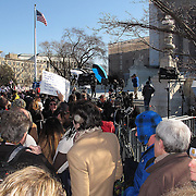 Demonstrators hold signs and march outside the Supreme Court in Washington D.C. on Tuesday, March 26, 2013, where the justices were hearing arguments on California's voter approved ban on same-sex marriage called Proposition 8. The Supreme Court waded into the fight over same-sex marriage Tuesday, at a time when public opinion is shifting rapidly in favor of permitting gay and lesbian couples to wed, but 40 states don't allow it. (AP Photo/ Alex Menendez)