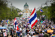 17 FEBRUARY 2014 - BANGKOK, THAILAND: Anti-government protestors jam Ratchadamnoen Avenue between Government House and the Ministry of Education in Bangkok. The anti-government protest movement, led by the People's Democratic Reform Committee and called Shutdown Bangkok has been going on for more than a month. The protest movement called, the People's Democratic Reform Committee (PDRC), wants to purge the current ruling party and its patrons in the Shinawatra family from Thai politics. The movement has consistently refused any dialogue or negotiations with the Pheu Thai ruling party. Over the weekend Thai police claimed to have taken the protest areas around Government House (the Prime Minister's office) away from protestors but on Monday protestors marched unimpeded to Government House and retook the area.   PHOTO BY JACK KURTZ