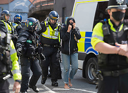 © Licensed to London News Pictures; 04/06/2021; Bristol, UK. A woman is removed but not arrested by police as police mount a major operation to enter the former Salvation Army building on Dean Lane in Bedminster which has been squatted and arrested 3 people suspected of criminal activity connected with the squatted occupation of buildings in High Street in Bristol city centre which was repossessed earlier this morning by Bailiffs accompanied by around 100 police, but those occupying the buildings in High Street had already left. Those arrested at the Salvation Army building are a 40-year-old man on suspicion of assaulting an emergency worker and escaping lawful custody, a 26-year-old man on suspicion of assaulting an emergency worker and escaping lawful custody, and a woman on suspicion of affray. Police were not evicting the Salvation Army building on Dean Lane as they do not have powers to do so. Photo credit: Simon Chapman/LNP.