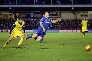 AFC Wimbledon defender Barry Fuller (2) fouled by Oxford United striker Marvin Johnson (28) during the EFL Sky Bet League 1 match between AFC Wimbledon and Oxford United at the Cherry Red Records Stadium, Kingston, England on 14 January 2017. Photo by Matthew Redman.