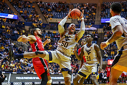 Dec 1, 2018; Morgantown, WV, USA; West Virginia Mountaineers forward Sagaba Konate (50) grabs a rebound during the first half against the Youngstown State Penguins at WVU Coliseum. Mandatory Credit: Ben Queen-USA TODAY Sports
