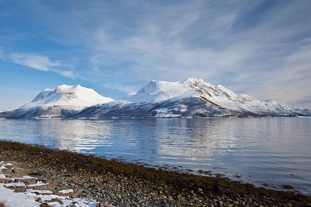 Kvaloya Island and the arctic alps and fjord near Tromso in the Arctic Circle, Northern Norway
