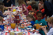 Kids enjoying home-made cakes at a neighbourhood street party in Dulwich, south London celebrating the Diamond Jubilee of Queen Elizabeth. A few months before the Olympics come to London, a multi-cultural UK is gearing up for a weekend and summer of pomp and patriotic fervour as their monarch celebrates 60 years on the throne and across Britain, flags and Union Jack bunting adorn towns and villages.