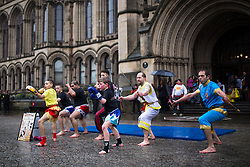 © Licensed to London News Pictures . 22/02/2015 .  Manchester , UK . Performances of martial arts in Albert Square . Crowds stand out in the snow to watch Chinese New Year celebrations in Manchester today ( Sunday 22nd February 2015) . Photo credit : Joel Goodman/LNP